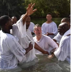 Darrib Gray and Baptism NFL Pros in the Jordan River